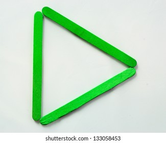 Green wood bar separated to play symbol on isolated white
