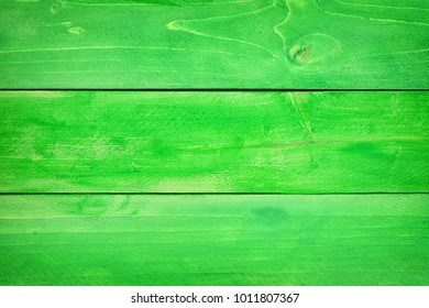 Green wood planks textured background. St Patricks Day concept.
