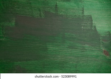 Green wood texture and background for design, closeup view of green wooden rustic table.