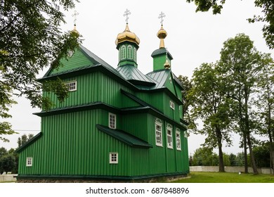 Green wooden antique building of the orthodox church of Michael the Archangel, Podlasie, Poland