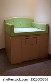 green wooden Baby Changing Station