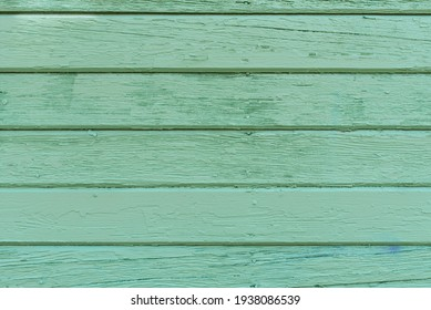 Green wooden background made of old boards for copying space. Mint color