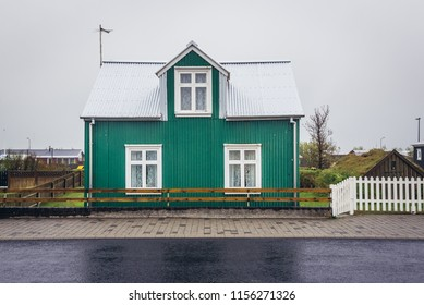 Green wooden cottage in Eyrarbakki, small village in southern Iceland