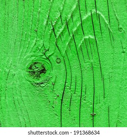 Green wooden surface with knot, closeup background photo texture