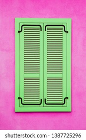 Green wooden window shutter. Pink paint wall architecture background.