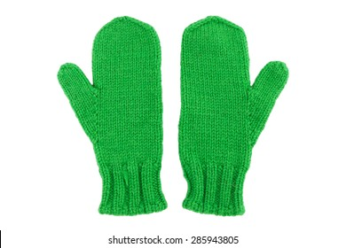 Green wool mittens on white isolated