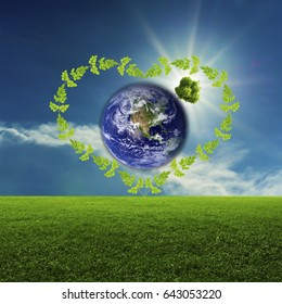 Green world concept. Green field and the sky top on the world inside green leaf. Elements of this image furnished by NASA.