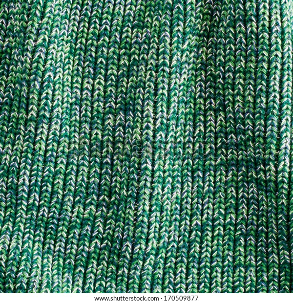 Green woven wool fabric as a background