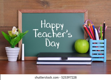 Green writing board with word Happy Teacher's Day