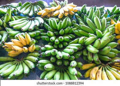 Green and yellow bananas on display for sale at Fugalei fresh produce market, Apia, Samoa, South Pacific