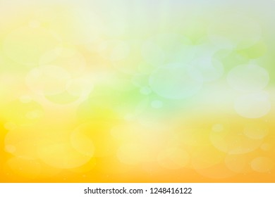 Green and yellow blurred abstract background with magic lights