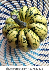 Green and yellow dumpling squash in basket
