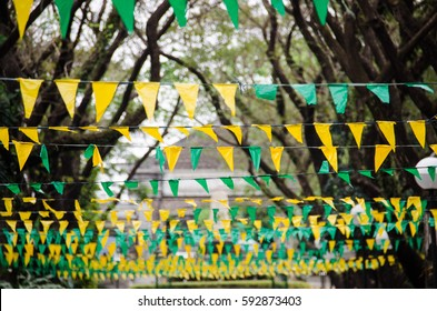 Green and yellow flaglets with tress on the background