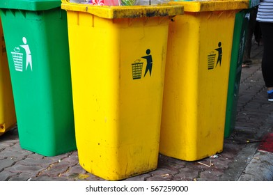 Green and yellow garbage bins for recycling