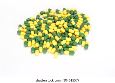green and yellow medicines capsules