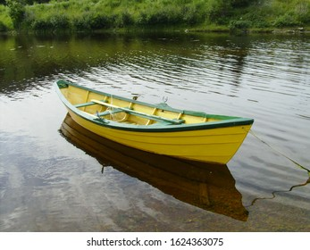 Green and yellow Newfoundland dory boat