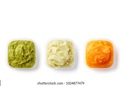 Green, yellow and orange baby puree in plastic containers isolated on white background, top view