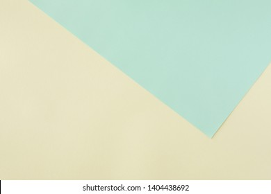 Green and yellow pastel paper color for background, top view