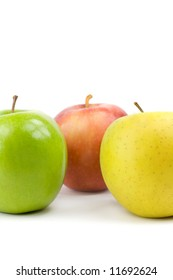 Green, yellow and red apple on white background