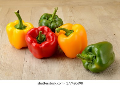green, yellow and red bell pepper