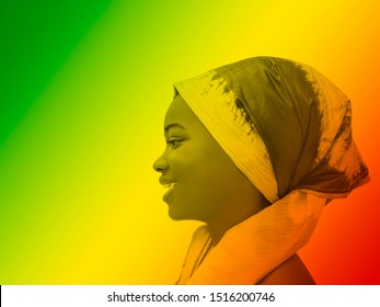 Green, yellow and red portrait of a smiling girl wearing a headscarf, profile view
