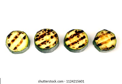 green zucchini grilled with dark stripes from the grill on white background for isolation