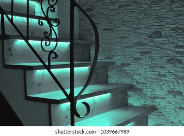 Green.blue (turquoise) LED lighting wooden stairs with antique railing