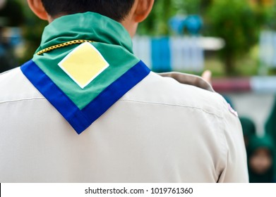Green,blue and yellow frame  scout scarf of Thailand scoutmaster.And blurry Muslim scouts background. Concept is learning Scout subject at school has Muslim students.