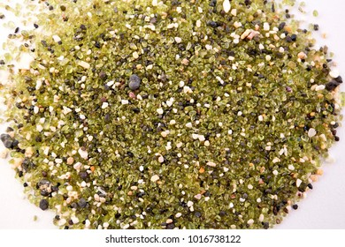 The greenest Papakolea Beach sand closeup on white