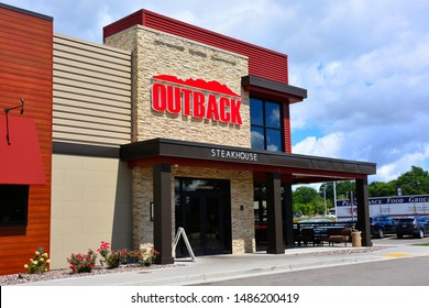 Greenfield, Wisconsin / USA - August 23, 2019:  The front of the local Outback Steakhouse on Sura Lane.