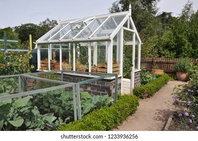 Greenhouse in English cottage garden