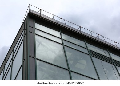 Greenhouse with glass walls and panoramic windows for growing exotic plants in cloudy weather