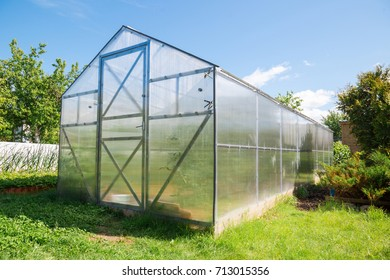 Greenhouse made of polycarbonate with a triangular roof