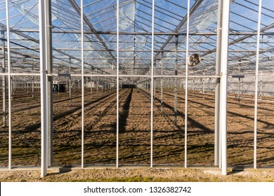 Greenhouse with soil and ready to plant at Maasdijk in the Westland in the Netherlands.