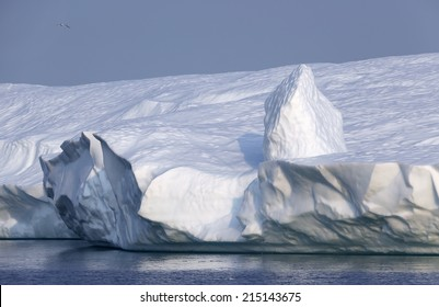 Greenland. The biggest glacier on a planet Jakobshavn. Huge icebergs of different forms in the gulf. Studying of a phenomenon of global warming.