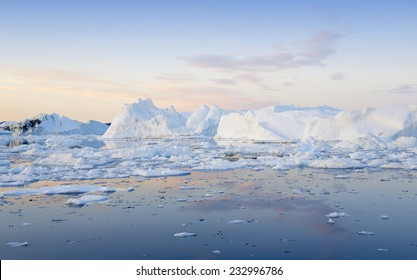 Greenland. Centuries-old thicknesses of glaciers. Icebergs of unusual forms. Research of a phenomenon of global warming and catastrophic thawing of ices.