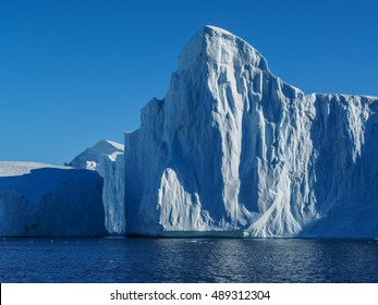 Greenland. Centuries-old thicknesses of glaciers. Icebergs of unusual forms. Research of a phenomenon of global warming