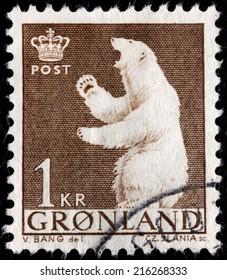GREENLAND - CIRCA 1964: A stamp printed by DENMARK shows image of  splendid engraving - Slania master piece of the Greenlandic Polar Bear, circa 1964