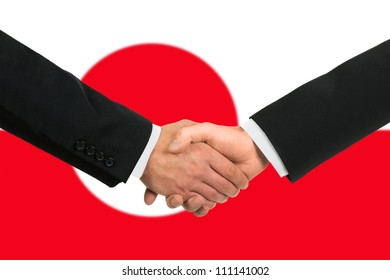 The Greenland flag and business handshake