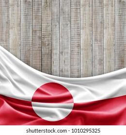 Greenland flag of silk and wood background -3D illustration