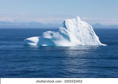 Greenland floating iceberg in deep blue ocean water. Global warming concept objet