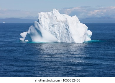 Greenland floating iceberg in deep blue ocean water. Global warming concept objet