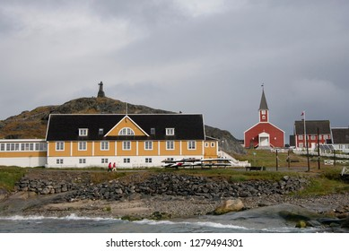 Greenland, Nuuk. Nuuk is the capital of Greenland and the country's largest city with a population of about 15,800. Harbor view of the historic district with Our Saviors' Church in the distance. .
