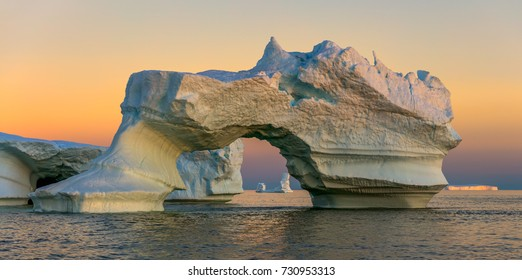 Greenland. Quaint icebergs of different forms in the Disko Bay. Their source is by the Jakobshavn glacier. This is a consequence of the phenomenon of global warming and catastrophic thawing of ice