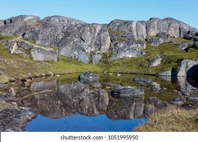 Greenland tundra rocks. North landscape