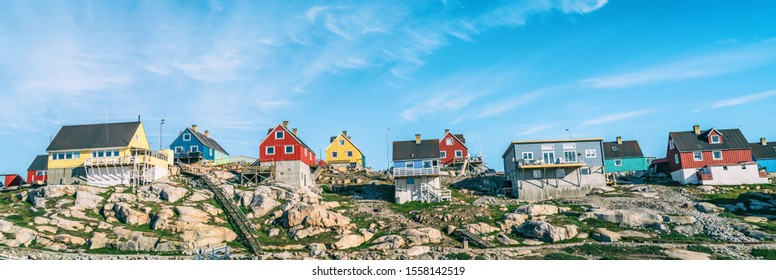 Greenland view of houses in Ilulissat City and icefjord. Tourist destination in the actic. Panoramic photo of typical Greenland village houses.