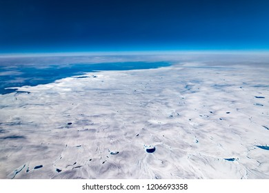 Greenland View on Airplane,Frozen Mountains Above,Glaciers Greenland top view greenland,
