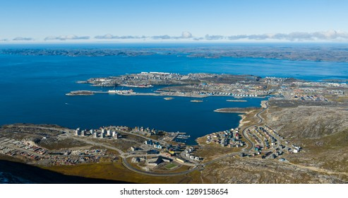 Greenlands capital Nuuk - largest city in Greenland aerial view. Drone image of Nuuk from air, aka Godthaab seen from Mountain Sermitsiaq aslso showing Nuup Kangerlua fjord.