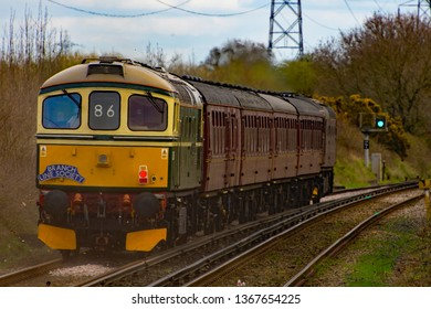 Green-liveried Class 33/0 No. 33012 (D6515) with 33029 leading, through Capenhurst, 29 Mar 2019.  This tour was the BLS Ruby Vampire-2nd Bite tour of rail lines around Merseyside and NW UK