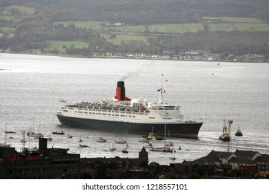 """""""Greenock, Inverclyde / Scotland - September 20 2007: QE2 on her final trip around the UK on the River Clyde reversing into the channel"""""""